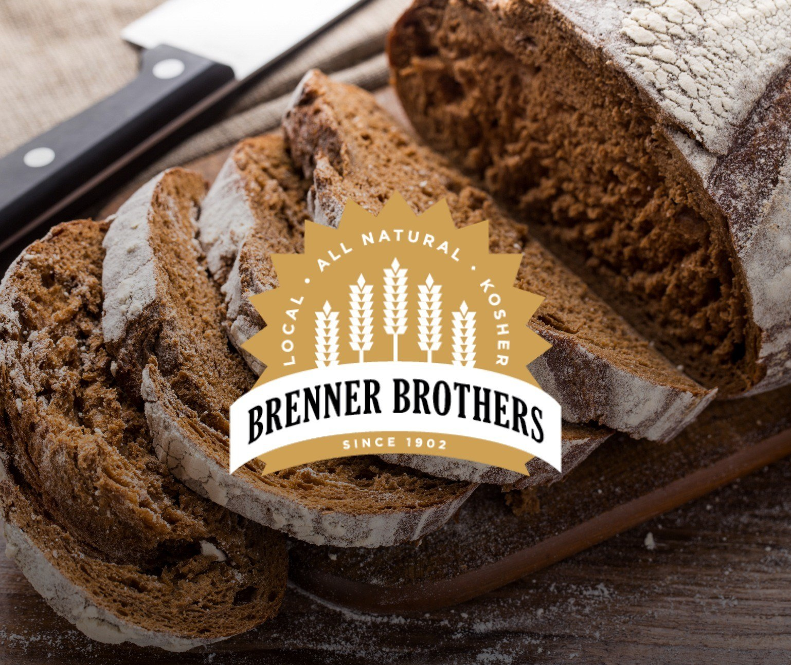 Logo with wheat in mustard over an image of sliced rye bread
