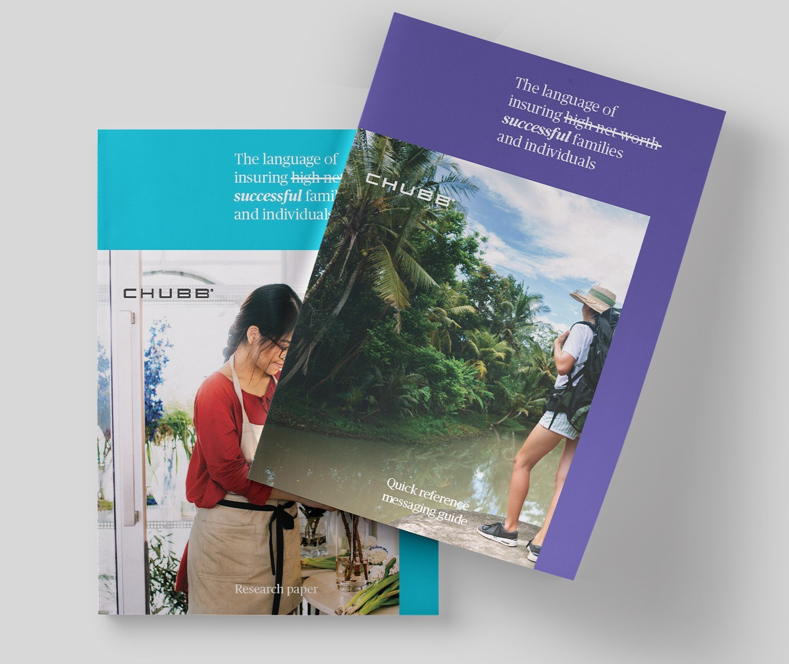 Two flagship brochures, one teal, one purple, overlapping on a grey background.
