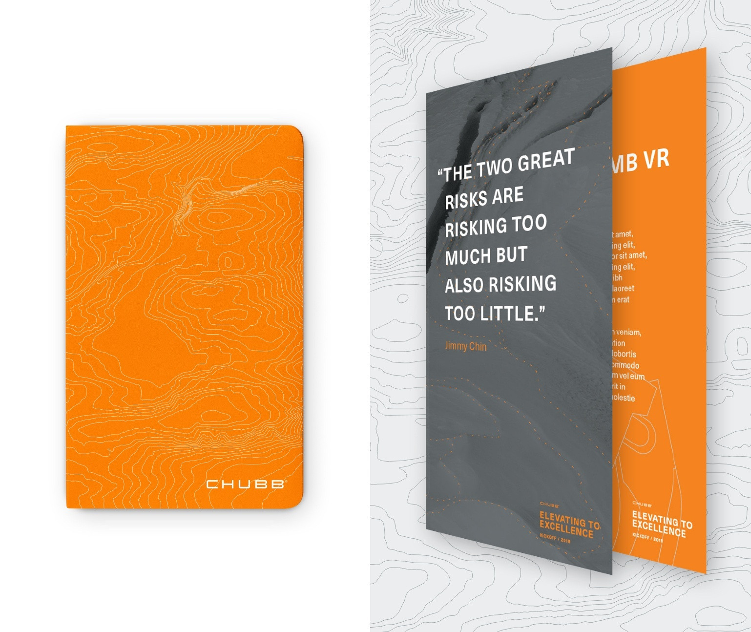 Orange notebook and two posters shown at an angle
