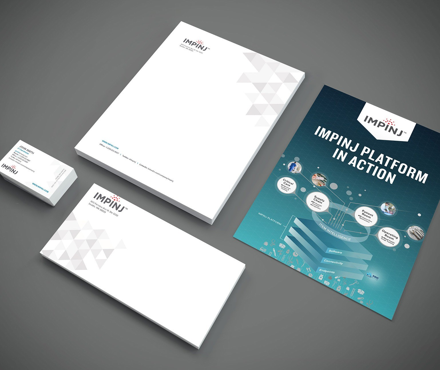 Impinj marketing collateral on a grey table