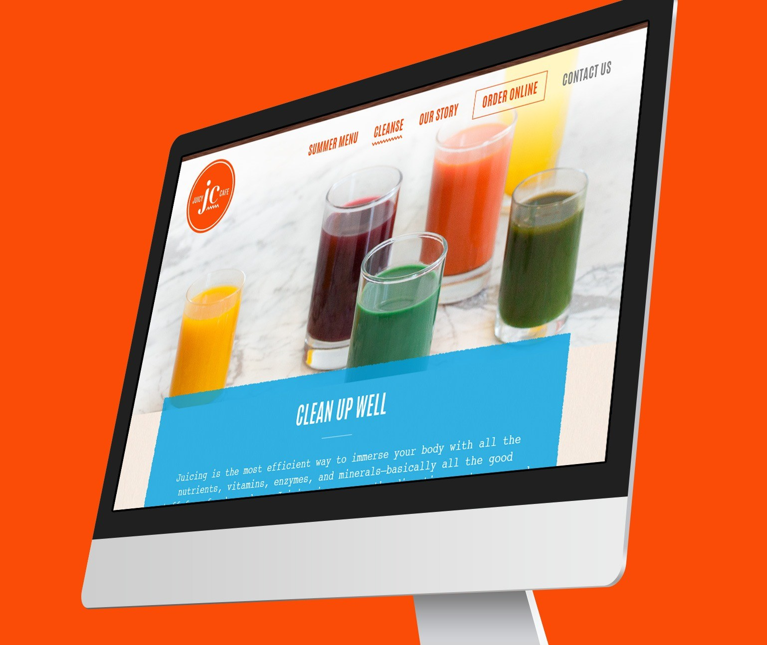 Juicy Cafe website design shown on computer monitor with an orange background