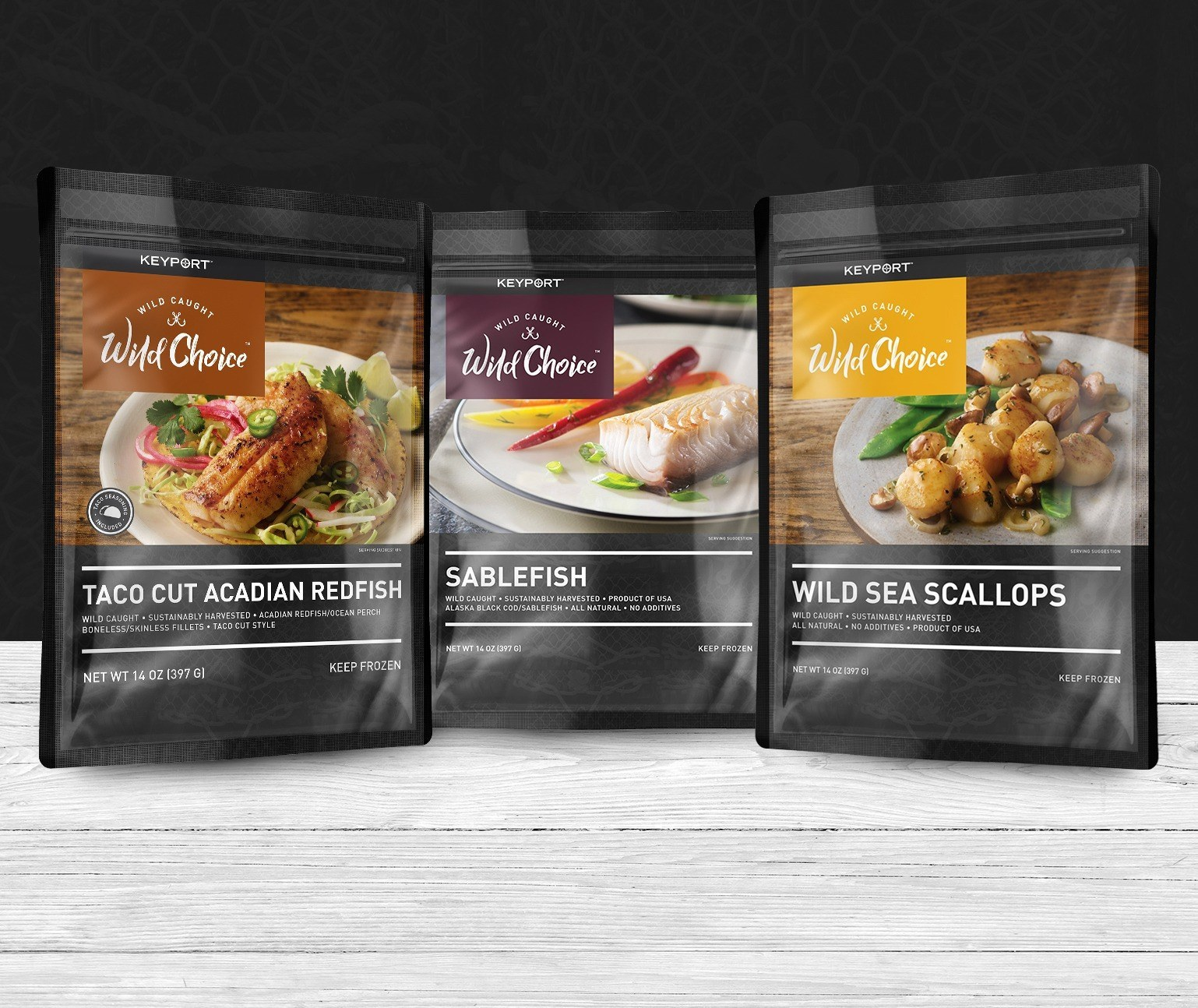 Three black seafood bags on a black and grey background