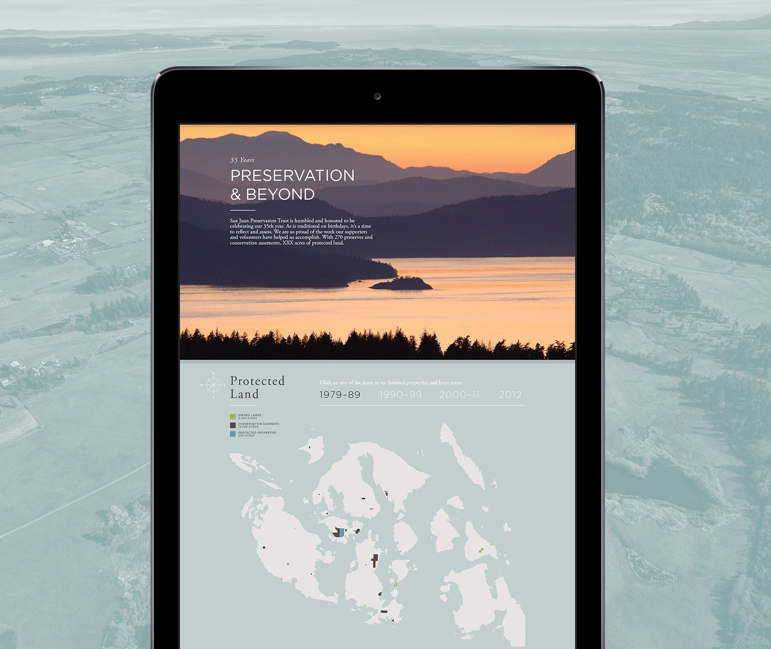 San Juan Preservation Trust website shown on a tablet with a background of an image of the San Juan Islands