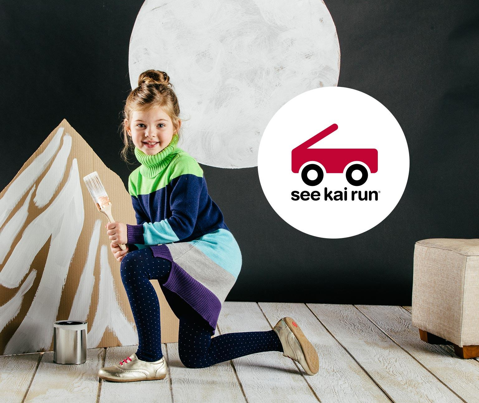 Young girl with a paint brush and See Kai Run logo
